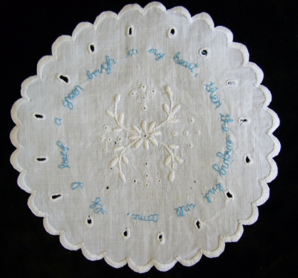 Chinese proverb on white work doily